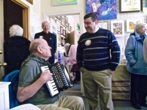Image by: Crystal Cobb Accordion Player with John Tousignant Director of Franco-American Centre Manchester NH